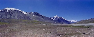 The Khunjerab Pass on the China-Pakistan border.  At 15,000 feet, it's the highest altitude border crossing in the world.