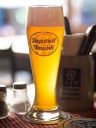 A tall cold glass of an Augustiner Weissbier.