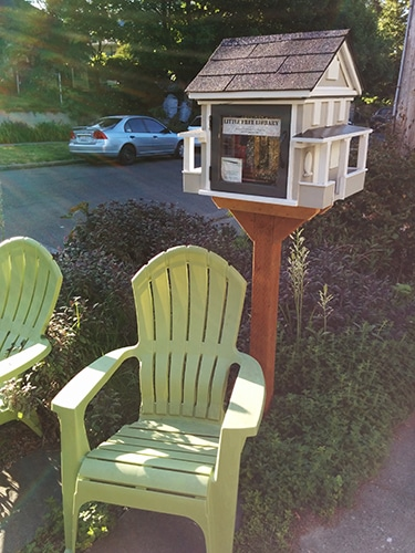 Little Free Library with green chairs