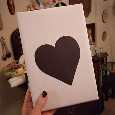 wrapped book with a black heart on the front for blind date with a book